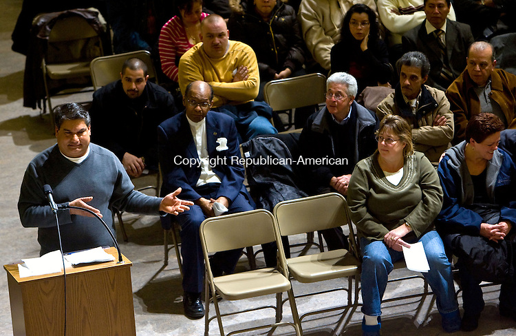 WATERBURY, CT - 06 JANUARY 2009 -010609JT07-<br /> Dennis Rivera, a resident of East Dover Street in the South End of Waterbury, speaks before the Board of Aldermen in favor of funding for the Loyola Development Corporation's revitalization project in his neighborhood during Tuesday's meeting at Waterbury Arts Magnet School.<br /> Josalee Thrift / Republican-American