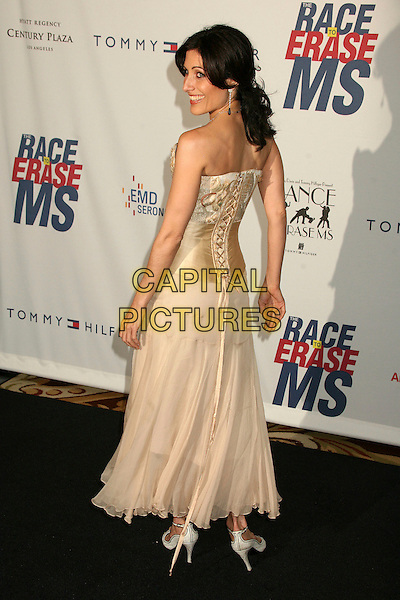 "LISA EDELSTEIN.14th Annual Race to Erase MS Themed ""Dance to Erase MS"" at the Century Plaza Hotel, Century City, California, USA, 13 April 2007..full length back behind cream gold corset strapless dress.CAP/ADM/BP.©Byron Purvis/AdMedia/Capital Pictures."