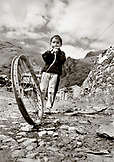 REPUBLIC OF GEORGIA, boy playing with a toy made out of an old bike rim (B&W)
