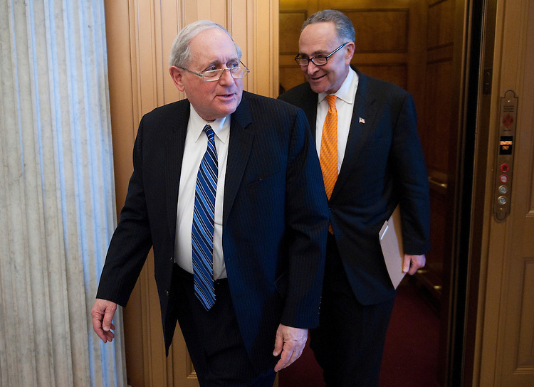 UNITED STATES – JANUARY 31: Sen. Carl Levin, D-Mich., left, and Sen. Charles Schumer, D-N.Y., arrive for the Senate Democrats' policy lunch on Tuesday, Jan. 31, 2012. (Photo By Bill Clark/CQ Roll Call)
