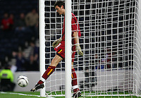 Matthew Ashton / Back Page Images..International Friendly..Scotland v USA..12th November, 2005..Scotland goalkeeper Craig Gordon kicks the ball out of the net after the USA scored to make it 0-1..--------------------..Jed Leicester  +44 7967091226..Javier Garcia  +44 7887794393..info@backpageimages.com..http://backpageimages.com/