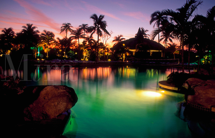 Atlantis Resort pool and lagoon at sunset. Paradise Island, Bahamas.