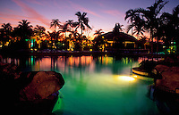 Atlantis Resort pool and lagoon at sunset. Paradise Island, Bahamas.
