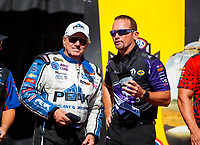 Sep 15, 2019; Mohnton, PA, USA; NHRA funny car driver John Force (left) with Jack Beckman during the Reading Nationals at Maple Grove Raceway. Mandatory Credit: Mark J. Rebilas-USA TODAY Sports