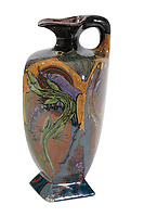 BNPS.co.uk (01202 558833)<br /> Pic: Duke's/BNPS<br /> <br /> A Den Haag glazed ewer decorated with lizards<br /> <br /> A collection of pottery that belonged to late Blue Peter presenter John Noakes is being sold by his widow for around £10,000.<br /> <br /> The 29 pieces of Rozenburg porcelain were collected by the 1970s TV star right up until his death, three years ago in 2017.<br /> <br /> Since then they have been in the ownership of his wife Vicky who has now decided the time is right to put them on the market.