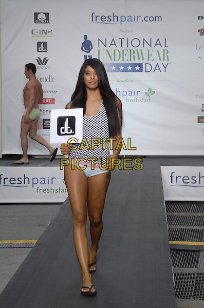 """DT CLOTHES MODEL.Freshpair.com presents the 5th annual """"National Underwear Day"""" at Times Square, New York, New York, USA..August 7th, 2007.full length flip flops catwalk knickers tank top lingerie.CAP/ADM/BL.©Bill Lyons/AdMedia/Capital Pictures *** Local Caption ***"""