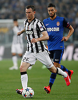 Calcio, quarti di finale di andata di Champions League: Juventus vs Monaco. Torino, Juventus stadium, 14 aprile 2015.<br /> Juventus' Stephan Lichsteiner, left, in action during the Champions League quarterfinals first leg football match between Juventus and Monaco at Juventus stadium, 14 April 2015.<br /> UPDATE IMAGES PRESS/Isabella Bonotto