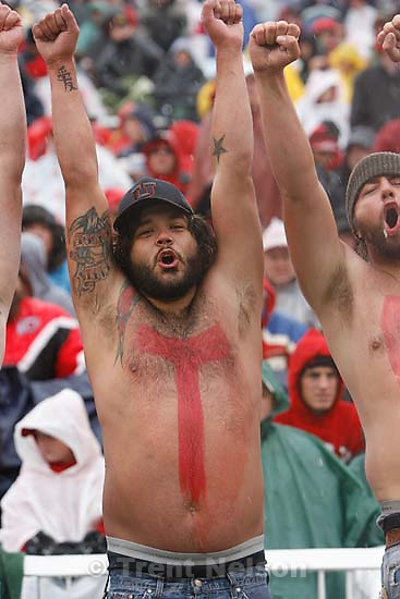 "shirtless Utah fans with ""Go Utes!"" painted on their bellies. Salt Lake City - Utah vs. Utah State college football Saturday afternoon at Rice-Eccles Stadium..; 9.29.2007"