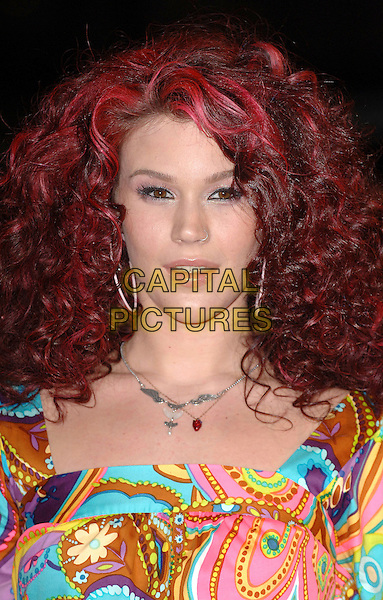 JOSS STONE.attending the 2007 Brit Awards, Earls Court, .London, England,14th February 2007..Brits portrait headshot fashion disaster yellow multi-coloured patterned printed mini dress red dyed hair curly.CAP/ BEL.©Tom Belcher/Capital Pictures.