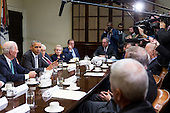 United States President Barack Obama, second left, speaks while meeting with current and former diplomatic and national security officials including James Baker, former U.S. Secretary of State, from left, Obama, Henry Kissinger, former U.S. Secretary of State, Madeleine Albright, former U.S. Secretary of State and founder of Albright Stonebridge Group LLC, Admiral Mike Mullen, former chairman of the U.S. Joint Chiefs of Staff, and Michael Froman, U.S. trade representative, to discuss the Trans-Pacific Partnership (TPP) in the Roosevelt Room of the White House in Washington, D.C., U.S., on Friday, November 13, 2015. Obama, hoping to kick off a new phase of selling the TPP at home while enhancing its prospects overseas, has enlisted some of the nation's top national security leaders to give testimonials. <br /> Credit: Andrew Harrer / Pool via CNP