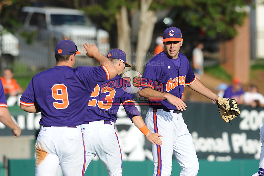 Clemson Tigers celebrate at the conclusion of  a  game against the Miami Hurricanes at Doug Kingsmore Stadium on March 31, 2012 in Clemson, South Carolina. The Tigers won the game 3-1.(Tony Farlow/Four Seam Images).
