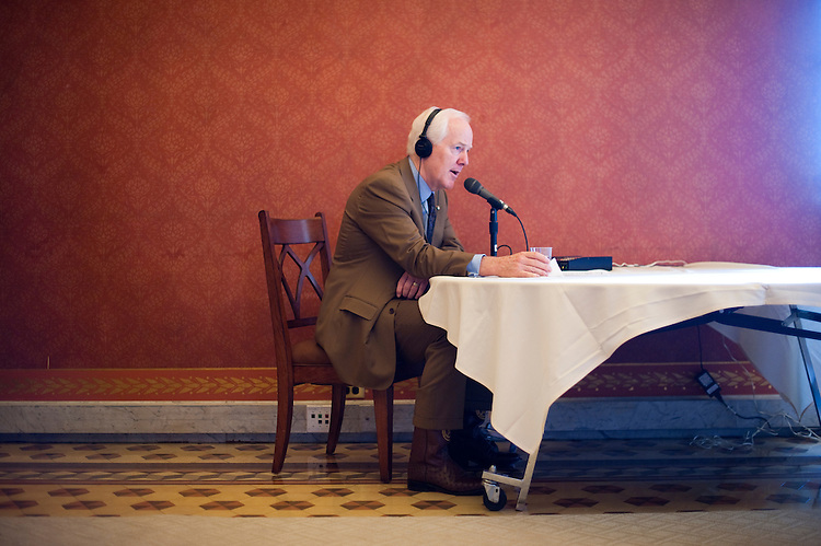 UNITED STATES - JULY 20: Sen. John Cornyn, R-Texas, does a talk radio interview during the Senate Republicans' radio row in the Strom Thurmond Room in the U.S. Capitol building on Wednesday, July 20, 2011. Republican Senators set up the radio row to talk about their positions on the debt ceiling talks. (Photo By Bill Clark/Roll Call)