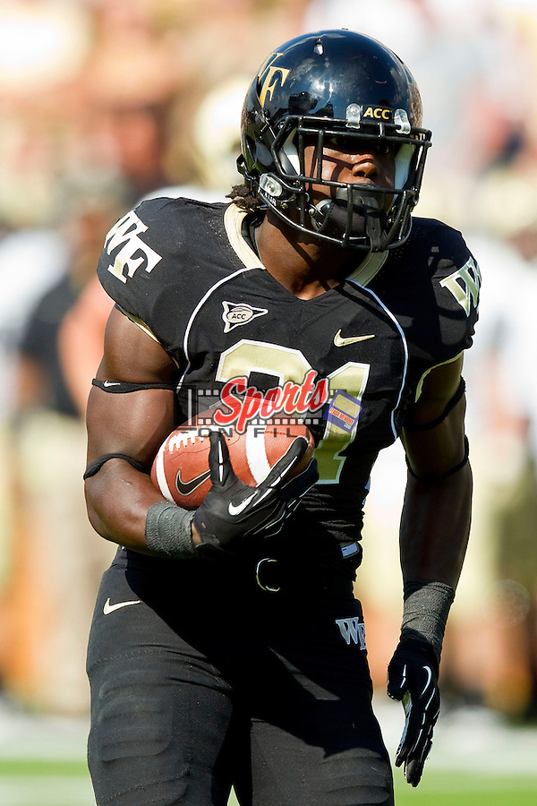 Deandre Martin (21) of the Wake Forest Demon Deacons gets some running room against the Army Black Knights at BB&T Field on September 22, 2012 in Winston-Salem, North Carolina.  The Demon Deacons defeated the Black Knights 49-37.  (Brian Westerholt/Sports On Film)