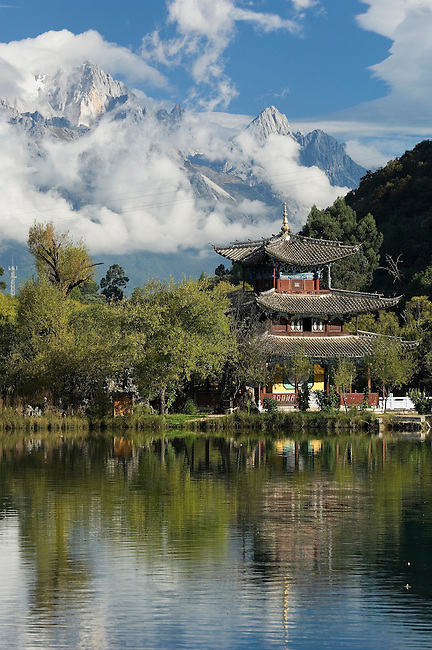 Deyue Lou Pagoda and bridge with Yulong Xue Shan, Jade Dragon Snow Mountain in background, Chinese