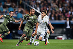 Vadis Odjidja Ofoe (l) of Legia Warszawa fights for the ball with Marco Asensio Willemsen of Real Madrid during the 2016-17 UEFA Champions League match between Real Madrid and Legia Warszawa at the Santiago Bernabeu Stadium on 18 October 2016 in Madrid, Spain. Photo by Diego Gonzalez Souto / Power Sport Images