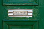 Close up of traditional style letterbox on front door of house in Evora, Alto Alentejo, Portugal