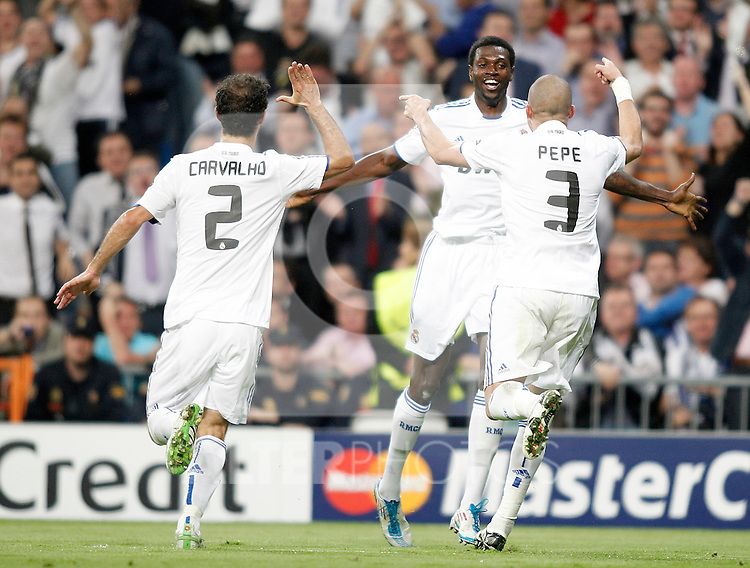 Real Madrid's Emmanuel Adebayor celebrates with Pepe and Ricardo Carvalho during Champions League Match. April 05, 2011. (ALTERPHOTOS/Alvaro Hernandez)