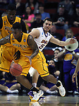 Wyoming's Hank Hankerson drives past Northern Iowa's Matt Bohannon (5) 2015 NCAA Division I Men's Basketball Championship March 20, 2015 at the Key Arena in Seattle, Washington.   Northern Iowa beat Wyoming 71 to 54.   ©2015.  Jim Bryant Photo. All Rights Reserved.