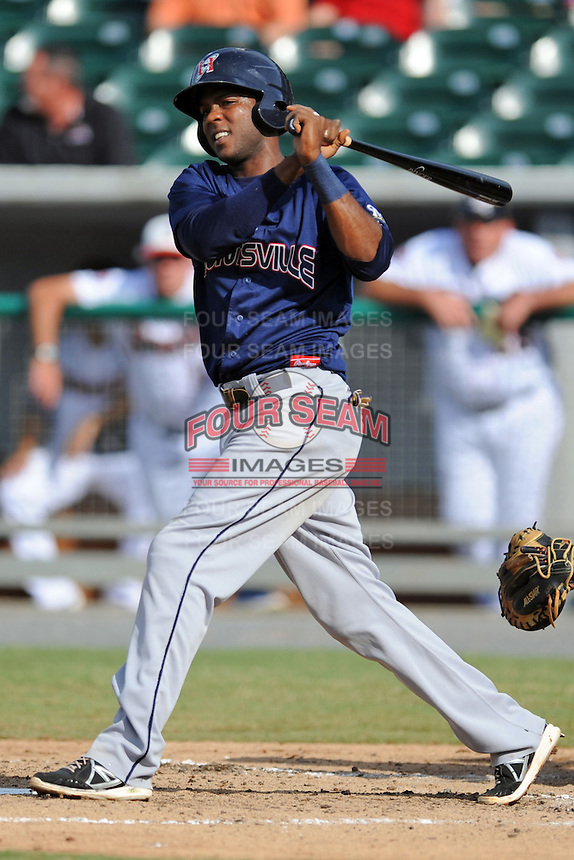 Huntsville Stars shortstop Hector Gomez #4 swings at a pitch during game one of a double header against the Tennessee Smokies at Smokies Park on July 8, 2013 in Kodak, Tennessee. The Stars won the game 2-0. (Tony Farlow/Four Seam Images)