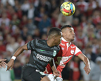 BOGOTÁ -COLOMBIA, 05-10-2014. Wilson Morelo (Der) jugador de Independiente Santa Fe disputa el balón con Wilder Guisao (Izq) jugador de Atlético Nacional por la fecha 13 de la Liga Postobón II 2014 jugado en el estadio Nemesio Camacho el Campín de la ciudad de Bogotá./ Wilson Morelo (R) player of Independiente Santa Fe fights for the ball with Wilder Guisao (L) player of Atletico Nacional during the match for the 13th date of Postobon League I 2014 played at Nemesio Camacho El Campin stadium in Bogotá city. Photo: VizzorImage/ Gabriel Aponte / Staff