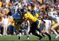 Sean Cattouse tackles Josh Smith. The California Golden Bears defeated the UCLA Bruins 35-7 at Memorial Stadium in Berkeley, California on October 9th, 2010.