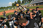 4 JUNE 2016:  Nova Southeastern University players celebrate with the trophy after defeating Millersville University to win  the Division II Men's Baseball Championship held at the USA Baseball National Training Complex in Cary, NC.  Nova Southeastern University defeated Millersville University 8-6 to win the national title.  Grant Halverson/NCAA Photos