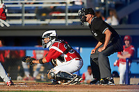 Batavia Muckdogs catcher Roy Morales (34) and umpire John Durante during a game against the Williamsport Crosscutters on July 15, 2015 at Dwyer Stadium in Batavia, New York.  Williamsport defeated Batavia 6-5.  (Mike Janes/Four Seam Images)