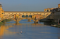 """The Ponte Vecchio is one of the most visited tourist sites in the renaissance city  of Florence Italy. It is line on both sides with jewelry shops and above them is part of the Famous""""Vasari corridor""""."""