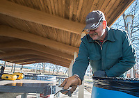 NWA Democrat-Gazette/ANTHONY REYES @NWATONYR<br /> Jerry Hamm, with Springdale Parks and Recreations department, paints a picnic table Wednesday, Feb. 15, 2017 in a pavilion at the Tyson Sports Complex in Springdale. Hamm with a crew is testing a small section to paint in the cooler weather to see if it will dry properly and removed remnants of decorations from the previous season's use. A Boy Scout Troop will reroof the pavilion soon.