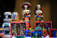 Souvenirs of the day of the dead are displayed for sell on a table while people take part in the Mexican anniversary of Day of the Dead in the Manhattan neighborhood, New York. 25.06.2015. Eduardo MunozAlvarez/VIEWpress.