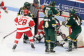 Holly Lorms (BU - 8) and Jill Cardella (BU - 22) wind up in the net with Roxanne Douville (Vermont - 34). - The Boston University Terriers tied the visiting University of Vermont Catamounts 2-2 on Saturday, November 13, 2010, at Walter Brown Arena in Boston, Massachusetts.