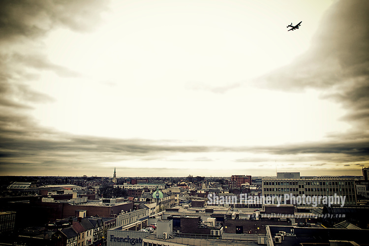 Pix: Shaun Flannery/shaunflanneryphotography.com...COPYRIGHT PICTURE>>SHAUN FLANNERY>01302-570814>>07778315553>>..22nd April 2013..A Lancaster Bomber fly's over Doncaster Town centre and Mansion House to mark the 100th birthday of Eric Clarke, a former member of Bomber Command.