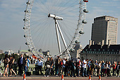 Tourists on Westminster Bridge, close to the London Eye.