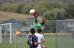 The Muncy High School goal keeper comes out of the box to make a save.