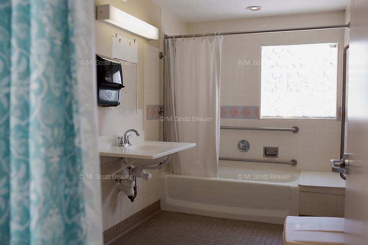 A view of bathroom facilities in one of the residences at Malone Park at the Fernald Center in Waltham, Massachusetts, USA.  Margaret is one of the few residents who can speak.
