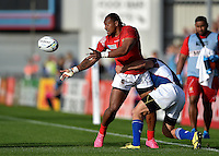 David Halaifonua of Tonga offloads the ball after being tackled. Rugby World Cup Pool C match between Tonga and Namibia on September 29, 2015 at Sandy Park in Exeter, England. Photo by: Patrick Khachfe / Onside Images