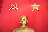 Vietnam. Hanoi. Military history museum. Statue of Ho Chí Minh (May 19, 1890 - September 2, 1969) who was a Vietnamese Communist revolutionary and statesman as Prime Minister (1946-1955) and President (1946-1969) of the Democratic Republic of Vietnam (North Vietnam). Ho Chí Minh led the Viet Minh independence movement from 1941 onward, establishing the communist-governed Democratic Republic of Vietnam in 1945 and defeating the French Union in 1954. He lost political power inside North Vietnam in the late 1950s, but remained as the highly visible figurehead president until his death. Red flag of the Vietnamese Communist Party.  04.04.09 © 2009 Didier Ruef