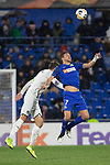 GETAFE, SPAIN - DECEMBER 12: FC Krasnodar's Sergey Petrov and Getafe CF's  Jaime Mata in action during the UEFA Europa League group C match between Getafe CF and FK Krasnodar at Coliseum Alfonso Perez on December 12, 2019 in Getafe, Spain. <br /> (ALTERPHOTOS/David Jar)