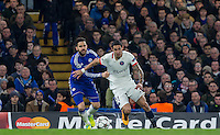 Angel Di Maria of Paris Saint-Germain & Cesc Fabregas of Chelsea in action during the UEFA Champions League Round of 16 2nd leg match between Chelsea and PSG at Stamford Bridge, London, England on 9 March 2016. Photo by Andy Rowland.