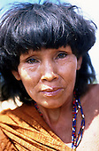 Para State, Amazon, Brazil. Ipixuna Village (Arawete); older woman with green eyes in traditional hand-woven cloth and beads.