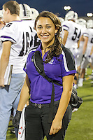 Student trainer Paige Derry poses for a portrait on the sidelines of a recent Cedar Ridge football game.  Photo taken September 27, 2013 at Hendrickson High School, Pflugerville, TX.  (LOURDES M. SHOAF/American-Statesman)
