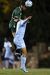 21 November 2013: USF's Samuel Hosseini (GER) (above) and North Carolina's Omar Holness (JAM) (14). The University of North Carolina Tar Heels hosted the University of South Florida Bulls at Fetzer Field in Chapel Hill, NC in a 2013 NCAA Division I Men's Soccer Tournament First Round match. North Carolina won the game 1-0.