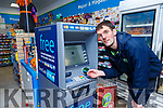 Kieran McAulliffe at the new ATM in his shop in Knocknagoshel village