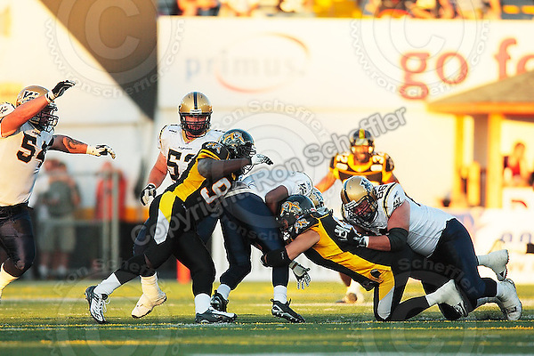 Aug 3, 2007; Hamilton, ON, CAN; Winnipeg Blue Bombers play the Hamilton Tiger-Cats at Ivor Wynne Stadium. The Tiger-Cats defeated the Blue Bombers 43-22. Mandatory Credit: Ron Scheffler. Pictured here is Hamilton Tiger-Cats defensive tackle (90) Clinton Wayne.