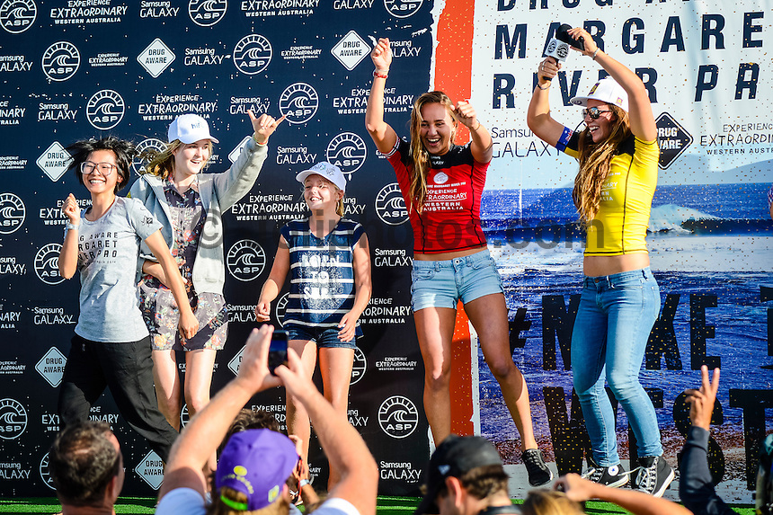 Margaret River, Western Australia. (Sunday April 6, 2014) Carissa Moore (HAW) winner and Tyler Wright (AUS) runner up celbrate on stage with members of the public. –  The 2014 Drug Aware Margaret River Pro World Championship Tour event continued this morning  in 4'-6' waves at the main break of Surfers Point. There was a light wind from the SW that put a bump on the ocean affecting the faces of the waves. The women's event was decided with Carissa Moore (HAW) defeating Tyler Wright (AUS) in a replay of last year's final. In the men's event Round 3 was completed.  Photo: joliphotos.com