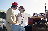 Sylvester Stalone, left, talks with Indy Car driver Alex Zanardi at Homestead-Maimi Speedway, Homestead, FL, before the Marlboro Grand Prix of Miami CART Indy Car race, March 26, 2000.  (Photo by Brian Cleary/www.bcpix.com)