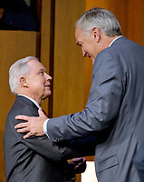 "United States Attorney General Jeff Sessions, left, shakes hands with his successor US Senator Luther Strange (Republican of Alabama) after he completed his testimony before the US Senate Select Committee on Intelligence to  ""examine certain intelligence matters relating to the 2016 United States election"" on Capitol Hill in Washington, DC on Tuesday, June 13, 2017.  In his prepared statement Attorney General Sessions said it was an ""appalling and detestable lie"" to accuse him of colluding with the Russians. Photo Credit: Ron Sachs/CNP/AdMedia"