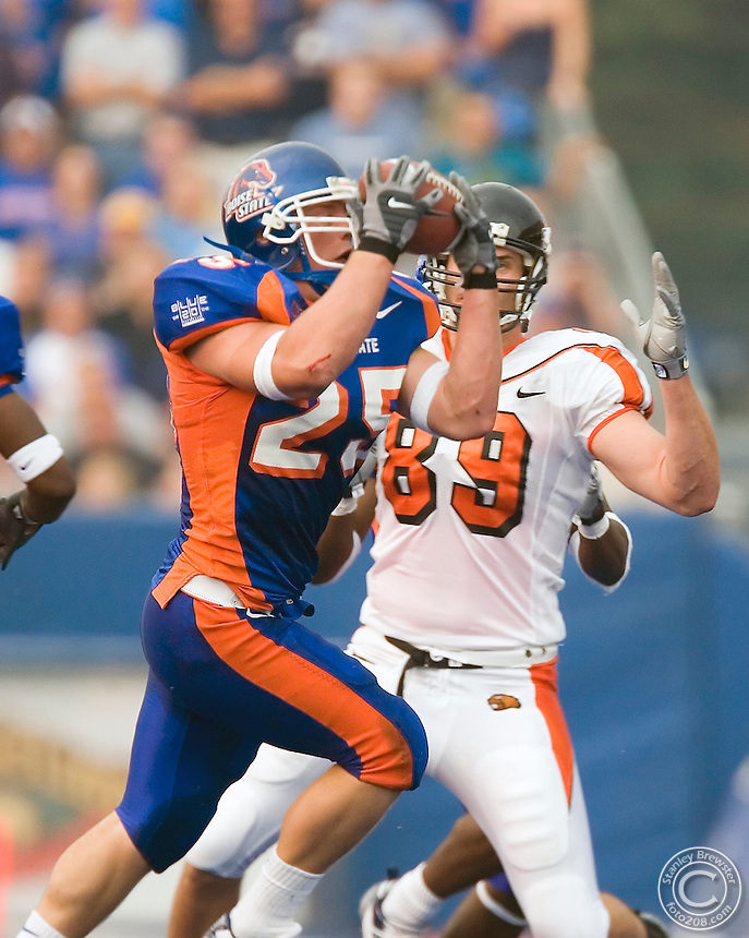 07 September 2006: Boise State linebacker Kory Hall steps up and intercepte a pass and returns it down close to the goalline for the Broncos in front of a sold-out crowd and a national ESPN audience as the Boise State Broncos stun the Oregon State Beavers 42-14 in Bronco Stadium in Boise Idaho.