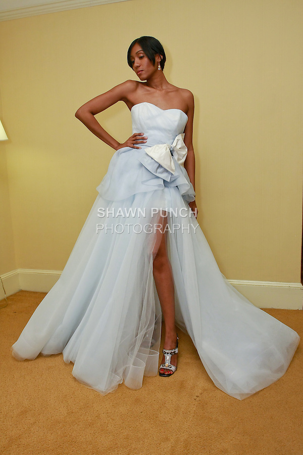 Model poses in a Valena Valentina Couture wedding dress by Elena Ham, during the WeddingChannel Bridal Market October 2010.
