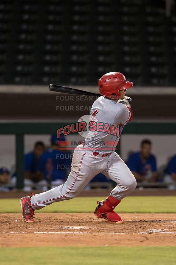 AZL Reds catcher Elvis Gomez (4) follows through on his swing during an Arizona League game against the AZL Cubs 1 at Sloan Park on July 13, 2018 in Mesa, Arizona. The AZL Cubs 1 defeated the AZL Reds 4-1. (Zachary Lucy/Four Seam Images)